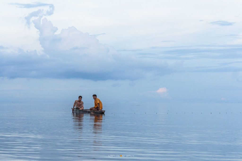 Two-man on the boat in Tanguar Haor , one of the best place in Bangladesh to visit
