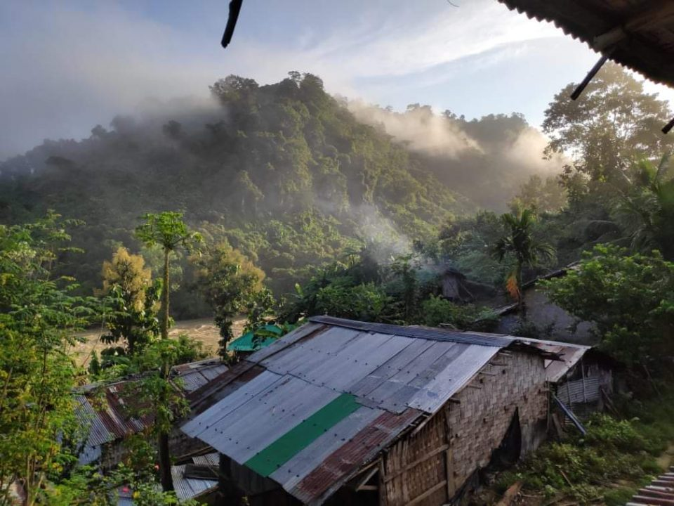 An amazing view of Tindu , a tin shed house and top of the mountain and white clouds at Bandarban in Bangladesh