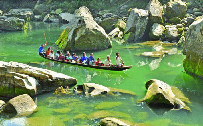 a bunch of travelers in Tindu on a boat floating, Bandarban, Bangladesh