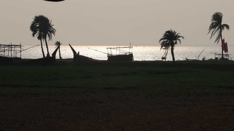 Wonderful tourist destination in Manpura Island in Bangladesh. Palm trees and lake and boat in its shadow form