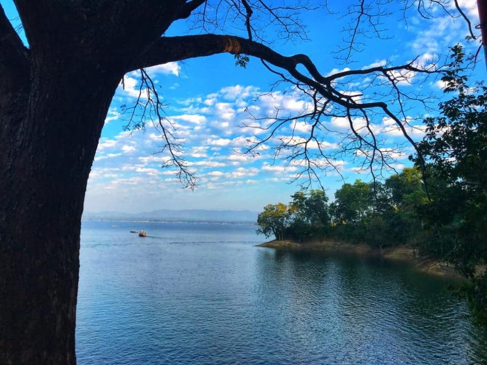 White cloud in the blue sky and blue water in Kaptai Lake.