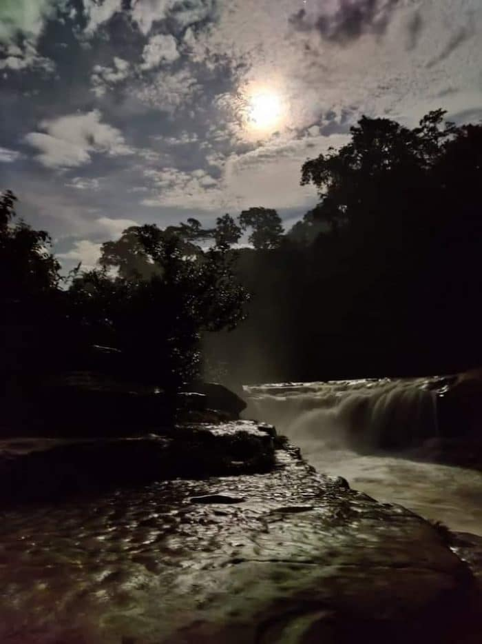 Night view of Nafakhum. A moon is shining in the sky and giving is silvery light in the Nafakhum waterfall.